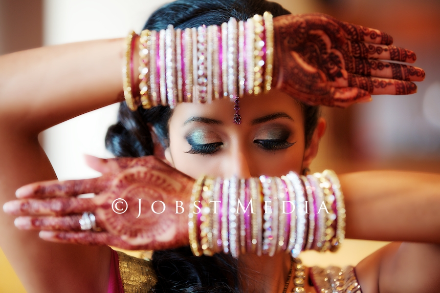 Indian Wedding Photographers Michigan bangles on an Indian bride's hands beautiful shot of hiding face