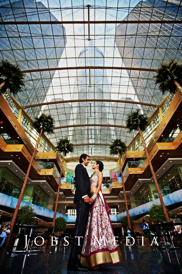 Indian Wedding Photographers Michigan wide angle inside tall building in the winter garden renaissance center