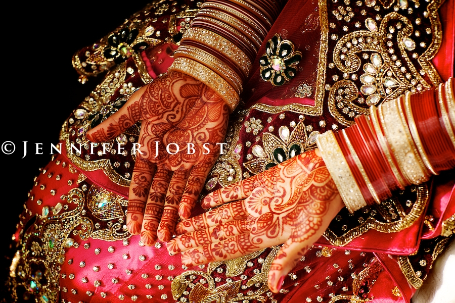 Indian Wedding Photographers Michigan stunning henna heads over the red dress of before the ceremony amazing shot