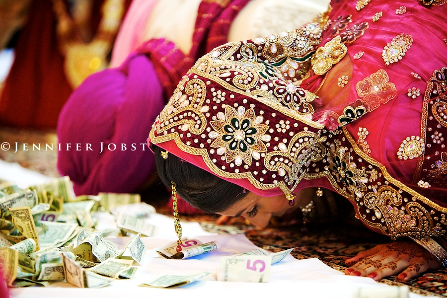 Indian Wedding Photographers Michigan Sikh ceremony brides head touching the floor during a prostration awesome shot