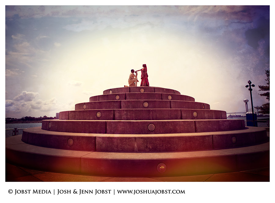 Indian Wedding Photographers Michigan circular stones rising up to the sky with couple like the top of a wedding cake