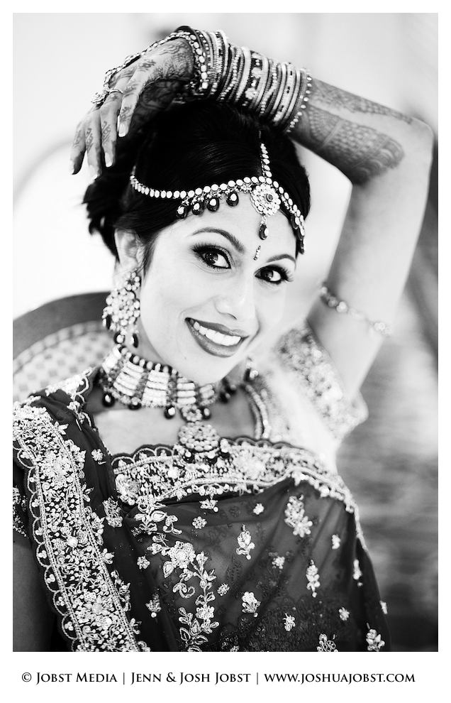 Indian Wedding Photographers Michigan black and white of smiling girl posing with arm over her head