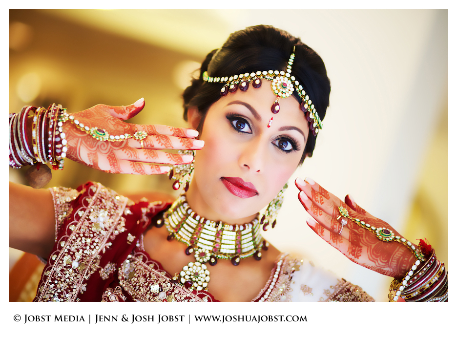 Indian Wedding Photographers Michigan bollywood colorful pose with hands seeming to fan the beautiful queen before her wedding